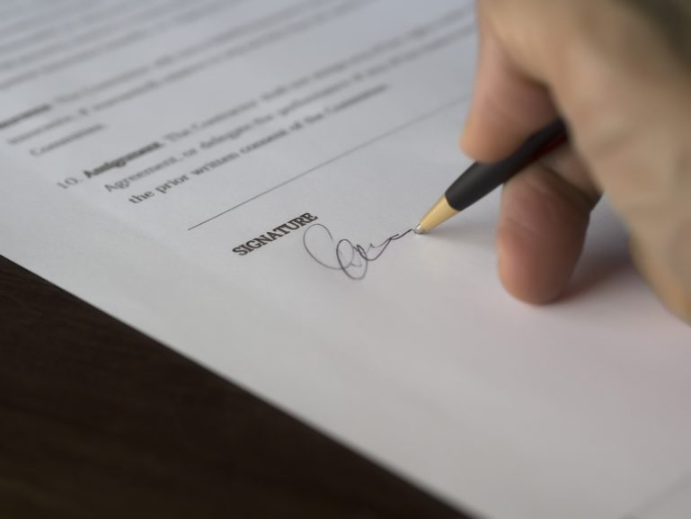 signing a contract document